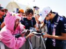 Esteban Ocon (FRA) Sahara Force India F1 Team with a fan dressed as the Pink Panther. Abu Dhabi Grand Prix, Saturday 25th November 2017. Yas Marina Circuit, Abu Dhabi, UAE.