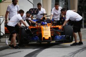 Bahrain International Circuit, Sakhir, Bahrain. Friday 6 April 2018. Mechanics push the Fernando Alonso McLaren MCL33 Renault in the pit lane.