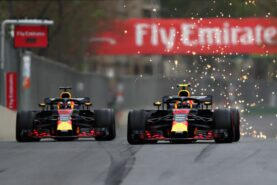 Daniel Ricciardo and Max Verstappen of the Netherlands driving the (33) Aston Martin Red Bull Racing RB14 TAG Heuer battle on track during the Azerbaijan Formula One Grand Prix 2018