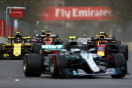 Max Verstappen driving the Red Bull Racing RB14 battles with Carlos Sainz of Spain driving the (55) Renault Sport Formula One Team RS18 on track during the Azerbaijan Formula One Grand Prix 2018