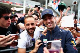 Daniel Ricciardo of Red Bull Racing poses for a selfie with a fan during previews ahead of the Spanish GP F1/2018.