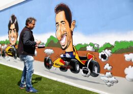An artist paints a Daniel Ricciardo of Australia and Red Bull Racing mural in the fan area during the Spanish Formula One Grand Prix at Circuit de Catalunya on May 13, 2018 in Montmelo, Spain.