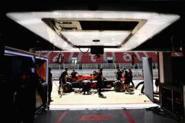 Red Bull mechanics around Max Verstappen's RB14