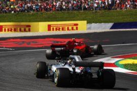 Lewis Hamilton chasing the Ferrari of Kimi Raikkonen with his Mercedes W09, Austria 2018