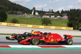 Daniel Ricciardo (Red Bull) passes Kimi Raikkonen (Ferrari) in turn 2