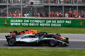 Max Verstappen driving the (33) Aston Martin Red Bull Racing RB14 TAG Heuer and Valtteri Bottas driving the (77) Mercedes AMG Petronas F1 Team Mercedes WO9 battle for track position at the start during the Canadian Formula One Grand Prix at Circuit Gilles Villeneuve on June 10, 2018 in Montreal, Canada.