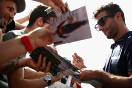 Daniel Ricciardo of Red Bull Racing signs autographs for fans in the Pitlane during previews ahead of the Formula One Grand Prix of France at Circuit Paul Ricard on June 21, 2018 in Le Castellet, France.