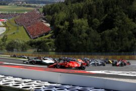 Kimi Raikkonen (Ferrari) going wide in turn 2 of lap 2 with the rest of the grid behind him.
