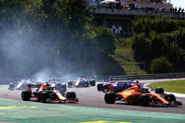 Stoffel Vandoorne of Belgium driving the (2) McLaren F1 Team MCL33 Renault leads Daniel Ricciardo of Australia driving the (3) Aston Martin Red Bull Racing RB14 TAG Heuer on track during the Formula One Grand Prix of Hungary at Hungaroring on July 29, 2018 in Budapest, Hungary.