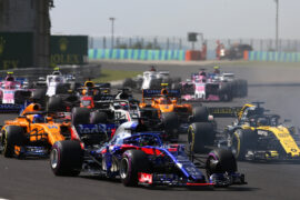 Brendon Hartley of New Zealand driving the (28) Scuderia Toro Rosso STR13 Honda leads Nico Hulkenberg of Germany driving the (27) Renault Sport Formula One Team RS18 and Fernando Alonso of Spain driving the (14) McLaren F1 Team MCL33 Renault into turn two during the Formula One Grand Prix of Hungary at Hungaroring on July 29, 2018 in Budapest, Hungary.