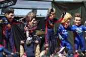 Performers dressed as, Daniel Ricciardo of Australia and Red Bull Racing, Romain Grosjean of France and Haas F1, Max Verstappen of Netherlands and Red Bull Racing, Brendon Hartley of New Zealand and Scuderia Toro Rosso and Pierre Gasly of France and Scuderia Toro Rosso entertain the crowds during qualifying for the Formula One Grand Prix of Belgium at Circuit de Spa-Francorchamps on August 25, 2018 in Spa, Belgium.