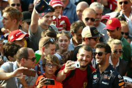 Daniel Ricciardo of Red Bull Racing poses for a photo with a fan during previews ahead of the Formula One Grand Prix of Italy at Autodromo di Monza on August 30, 2018 in Monza, Italy.