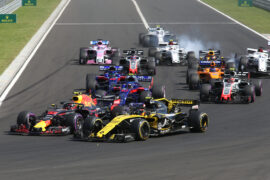 Carlos Sainz Jr (ESP) Renault Sport F1 Team RS18 and Max Verstappen (NLD) Red Bull Racing RB14 at the start of the race. Hungarian Grand Prix, Sunday 29th July 2018. Budapest, Hungary.