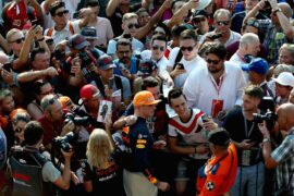 Max Verstappen of Netherlands and Red Bull Racing poses for a photo with fans during previews ahead of the Formula One Grand Prix of Italy at Autodromo di Monza on August 30, 2018 in Monza, Italy.