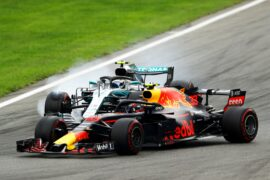 Max Verstappen driving the (33) Aston Martin Red Bull Racing RB14 TAG Heuer competes with Valtteri Bottas driving the (77) Mercedes AMG Petronas F1 Team Mercedes WO9 during the Formula One Grand Prix of Italy at Autodromo di Monza on September 2, 2018 in Monza, Italy.