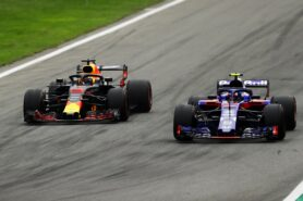Daniel Ricciardo driving the (3) Aston Martin Red Bull Racing RB14 TAG Heuer competes with Pierre Gasly of Scuderia Toro Rosso driving the (10) Scuderia Toro Rosso STR13 Honda during the Formula One Grand Prix of Italy at Autodromo di Monza on September 2, 2018 in Monza, Italy.