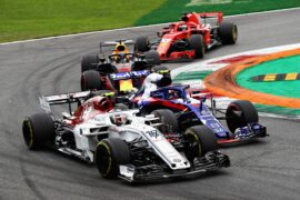 Charles Leclerc and Pierre Gasly battle for position during the Formula One Grand Prix of Italy at Autodromo di Monza on September 2, 2018 in Monza, Italy.