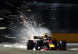 Sparks fly behind Max Verstappen of the Netherlands driving the (33) Aston Martin Red Bull Racing RB14 TAG Heuer on track during practice for the Formula One Grand Prix of Singapore at Marina Bay Street Circuit 2018.