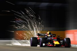 Sparks fly behind Daniel Ricciardo of Australia driving the (3) Aston Martin Red Bull Racing RB14 TAG Heuer on track during practice for the Formula One Grand Prix of Singapore at Marina Bay Street Circuit 2018.