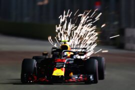 Sparks fly behind Max Verstappen of Red Bull Racing RB14 TAG Heuer on track during qualifying for the Formula One Grand Prix of Singapore 2018.