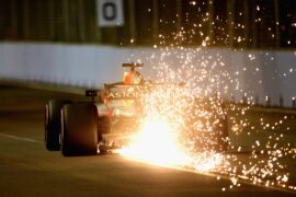 Sparks fly behind Daniel Ricciardo of Red Bull Racing RB14 TAG Heuer on track during qualifying for the Formula One Grand Prix of Singapore 2018.
