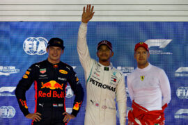 Top three qualifiers Lewis Hamilton of Great Britain and Mercedes GP, Max Verstappen of Netherlands and Red Bull Racing and Sebastian Vettel of Germany and Ferrari celebrate in parc ferme during qualifying for the Formula One Grand Prix of Singapore 2018.