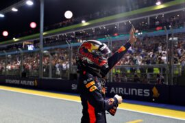 Second place qualifier Max Verstappen of Red Bull Racing celebrates in parc ferme during qualifying for the Formula One Grand Prix of Singapore 2018.