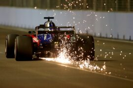 Sparks fly behind Brendon Hartley of New Zealand driving the (28) Scuderia Toro Rosso STR13 Honda on track during qualifying for the Formula One Grand Prix of Singapore 2018.