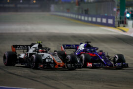 Kevin Magnussen driving the (20) Haas F1 Team VF-18 Ferrari and Brendon Hartley driving the (28) Scuderia Toro Rosso STR13 Honda battle for position during the Formula One Grand Prix of Singapore 2018.
