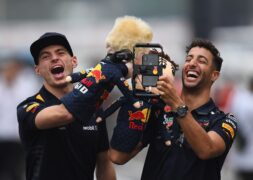 Daniel Ricciardo & Max Verstappen of Red Bull Racing film themselves playing with puppets during previews ahead of the Formula One Grand Prix of Japan at Suzuka Circuit on October 4, 2018 in Suzuka.