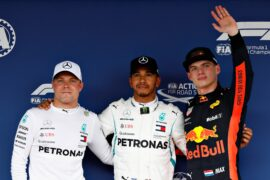 Top three qualifiers Lewis Hamilton of Great Britain and Mercedes GP, Valtteri Bottas of Finland and Mercedes GP and Max Verstappen of Netherlands and Red Bull Racing celebrate in parc ferme during qualifying for the Formula One Grand Prix of Japan at Suzuka Circuit on October 6, 2018 in Suzuka.