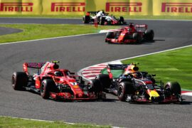 Kimi Raikkonen and Max Verstappen battle for position on track during the Formula One Grand Prix of Japan at Suzuka Circuit on October 7, 2018 in Suzuka.