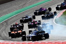 Daniel Ricciardo of Australia driving the (3) Aston Martin Red Bull Racing RB14 TAG Heuer is seen among others at the start during the Formula One Grand Prix of Japan at Suzuka Circuit on October 7, 2018 in Suzuka.