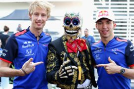 Pierre Gasly of France and Scuderia Toro Rosso and Brendon Hartley of New Zealand and Scuderia Toro Rosso meet a Day of the Dead performer in the Paddock during previews ahead of the Formula One Grand Prix of Mexico at Autodromo Hermanos Rodriguez on October 25, 2018 in Mexico City, Mexico.