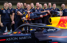 Daniel Ricciardo of Red Bull Racing poses for a photo with his team in the Pitlane during previews ahead of the Abu Dhabi Formula One Grand Prix at Yas Marina Circuit on November 22, 2018 in Abu Dhabi, United Arab Emirates.