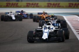 Yas Marina Circuit, Abu Dhabi, United Arab Emirates. Sunday 25 November 2018 Lance Stroll, Williams FW41, leads Kevin Magnussen, Haas F1 Team VF-18, and Stoffel Vandoorne, McLaren MCL33.