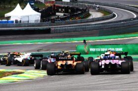 Esteban Ocon (FRA) Racing Point Force India F1 VJM11 and Stoffel Vandoorne (BEL) McLaren MCL33 at the start of the race. Brazilian Grand Prix, Sunday 11th November 2018. Sao Paulo, Brazil.