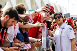 Sergio Perez (MEX) Racing Point Force India F1 Team with fans. Abu Dhabi Grand Prix, 2018