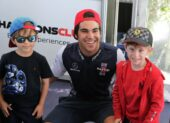 Stroll poses with kids