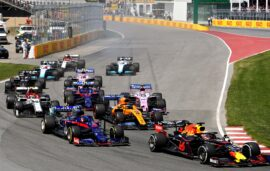 Max Verstappen of the Netherlands driving the (33) Aston Martin Red Bull Racing RB15 leads Daniil Kvyat driving the (26) Scuderia Toro Rosso STR14 Honda at the start during the F1 Grand Prix of Canada at Circuit Gilles Villeneuve on June 09, 2019 in Montreal, Canada.